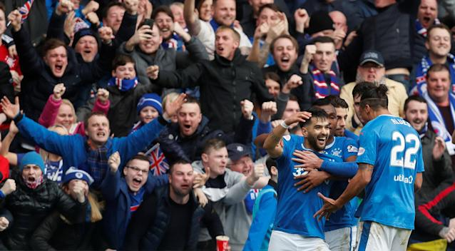Soccer Football - Scottish Premiership - Rangers vs Celtic - Ibrox, Glasgow, Britain - March 11, 2018 Rangers' Daniel Candeias celebrates scoring their second goal with team mates REUTERS/Russell Cheyne