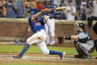 New York Mets' Pete Alonso, left, hits a home run during the seventh inning in the second game of a baseball doubleheader against the Miami Marlins, Monday, Aug. 5, 2019, in New York. (AP Photo/Mary Altaffer)