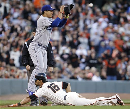 San Francisco Giants' Angel Pagan (16) slides safely with a triple as Los Angeles Dodgers third baseman Luis Cruz waits for the ball in the fifth inning of a baseball game, Sunday, Sept. 9, 2012, in San Francisco. (AP Photo/Ben Margot)