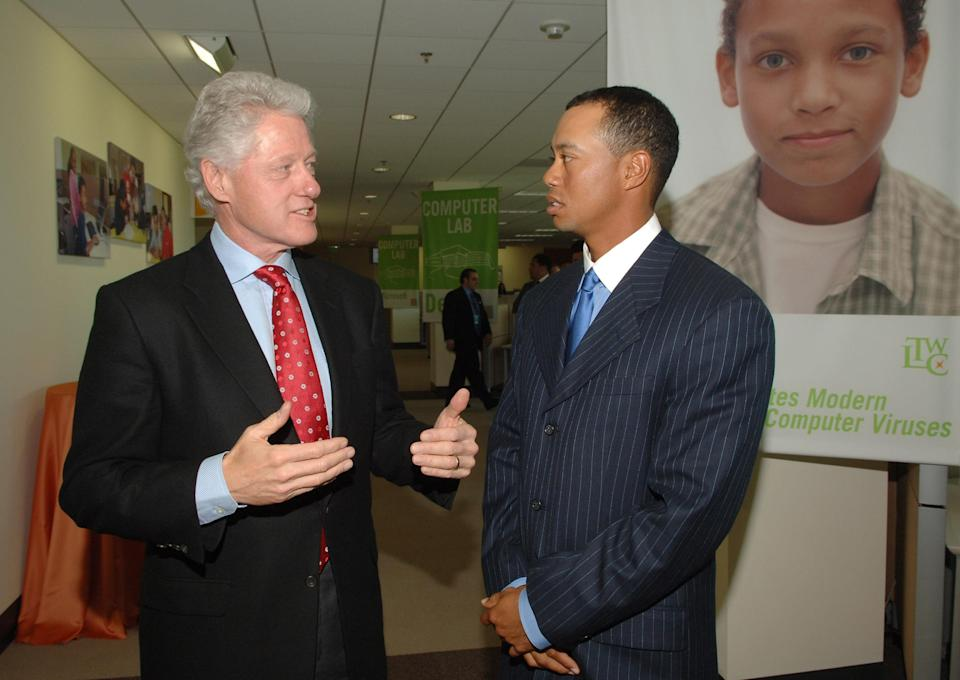 President Clinton and Tiger Woods. (Getty)