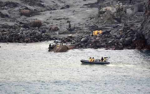 Six bodies have been successfully recovered from White Island and are now on board HMNZS Wellington - Credit: Getty