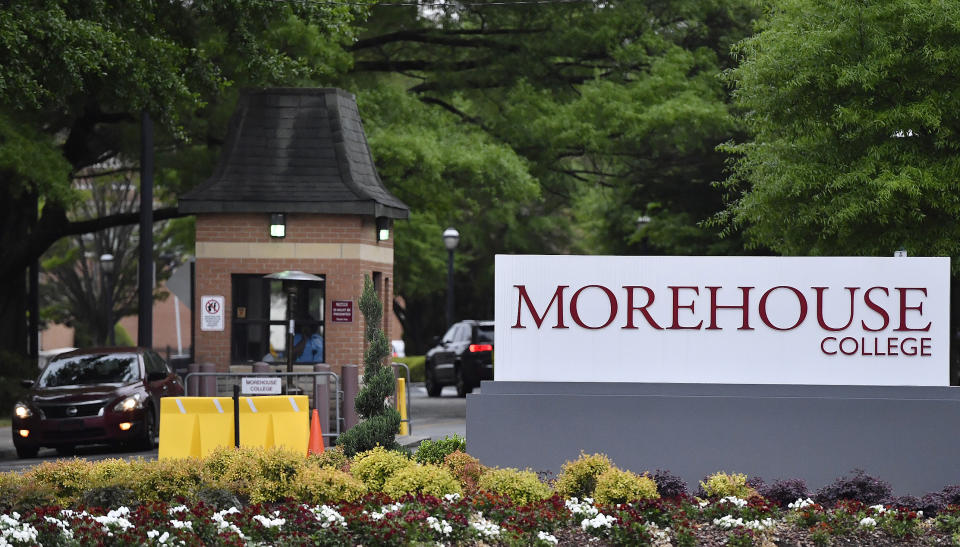 In this Friday, April 12, 2019 photo, people enter the campus of Morehouse College in Atlanta. One of the nation's top historically black colleges is cutting employee salaries and retirement contributions to increase student aid. The announcement Tuesday, Sept. 24, 2019, by Atlanta's Morehouse College comes months after billionaire Robert Smith promised to repay all student loans accumulated by Morehouse's class of 2019. That one-time gift will total $34 million after the college announced this week that Smith would also repay money borrowed by parents of Morehouse graduates. (AP Photo/Mike Stewart)