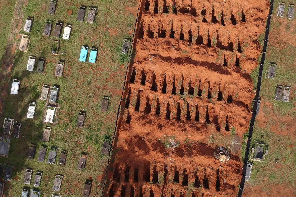 Freshly dug graves are exposed at the Campo da Esperanca cemetery in Brasilia, Brazil, Tuesday, March 23, 2021. The nation had an average of 2,235 deaths a day last week, the highest since the beginning of the COVID-19 pandemic. (AP Photo/Eraldo Peres)
