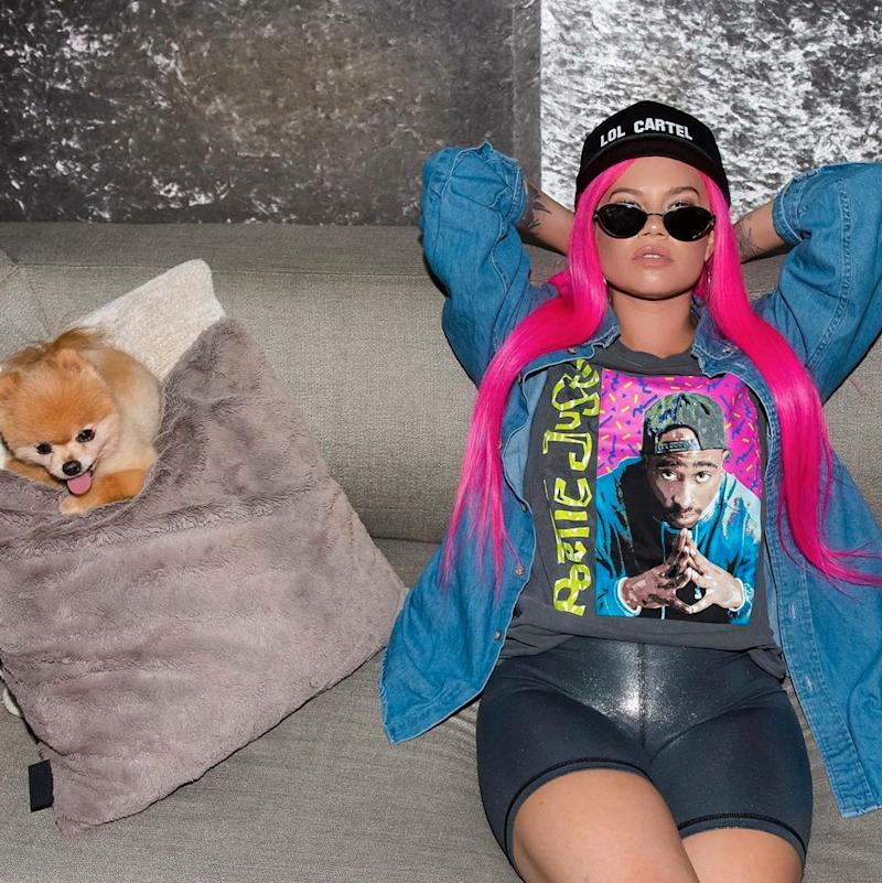 Chanel West Coast poses with pink hair