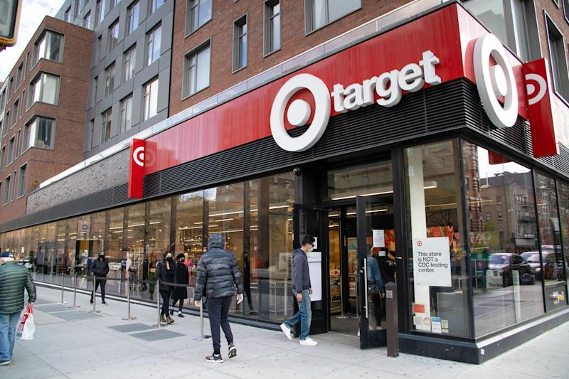 """NEW YORK CITY, UNITED STATES - 2020/04/17: A social distancing line is formed outside a Target store amid the coronavirus outbreak in NYC The governor of New York State, Andrew Cuomo, announced that New York will continue on """"PAUSE""""with non-essential businesses closed and shelter in place until May 15th. (Photo by Braulio Jatar/SOPA Images/LightRocket via Getty Images)"""