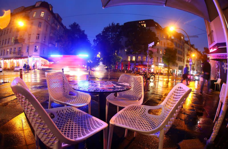 FILE PHOTO: An empty table is pictured before the late-night curfew due to restrictions against the spread of the coronavirus disease (COVID-19) in Berlin