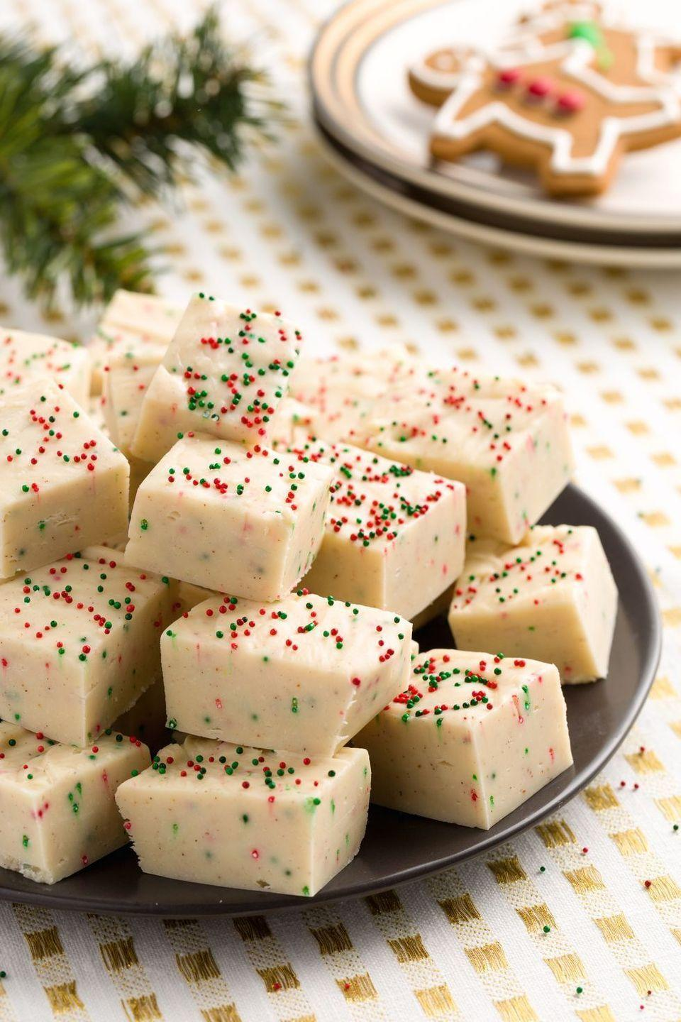"""<p>Here's a treat that'll make you wish you could reach through your screen and try a bite. <em>Yum. </em>Our favorite part? Those adorable, Christmas-themed sprinkles.</p><p><strong>Get the recipe at <a href=""""https://www.delish.com/cooking/recipe-ideas/recipes/a45064/gingerbread-fudge-recipe/"""" rel=""""nofollow noopener"""" target=""""_blank"""" data-ylk=""""slk:Delish"""" class=""""link rapid-noclick-resp"""">Delish</a>.</strong></p><p><strong><a class=""""link rapid-noclick-resp"""" href=""""https://www.amazon.com/s?k=white+chocolate+chips&i=grocery&ref=nb_sb_noss_2&tag=syn-yahoo-20&ascsubtag=%5Bartid%7C10050.g.645%5Bsrc%7Cyahoo-us"""" rel=""""nofollow noopener"""" target=""""_blank"""" data-ylk=""""slk:SHOP WHITE CHOCOLATE CHIPS"""">SHOP WHITE CHOCOLATE CHIPS</a><br></strong></p>"""