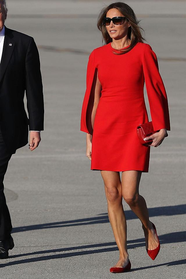 In a red Givenchy dress and flats while landing at the Palm Beach Airport to meet President Trump at Mar-a-Lago. (Photo: Getty Images)