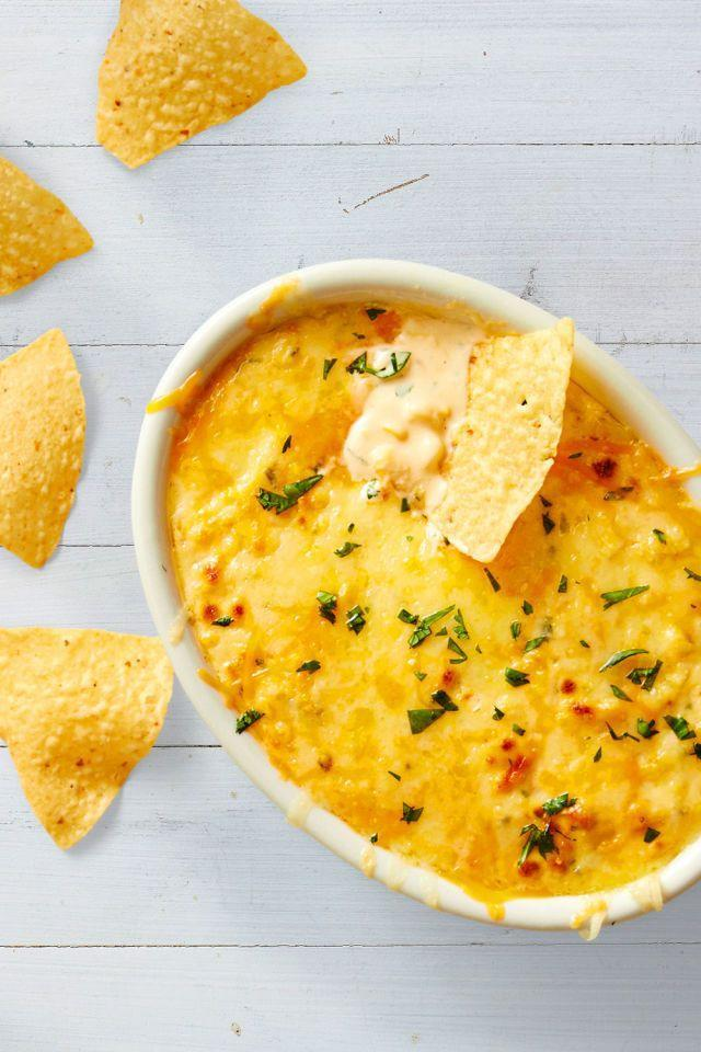 "<p>Cheese, corn, and tortilla chips — has there ever been a better trio? </p><p><em><a href=""https://www.goodhousekeeping.com/food-recipes/easy/a45237/warm-cheddar-corn-dip-recipe/"" rel=""nofollow noopener"" target=""_blank"" data-ylk=""slk:Get the recipe for Warm Cheddar Corn Dip »"" class=""link rapid-noclick-resp"">Get the recipe for Warm Cheddar Corn Dip »</a></em></p>"