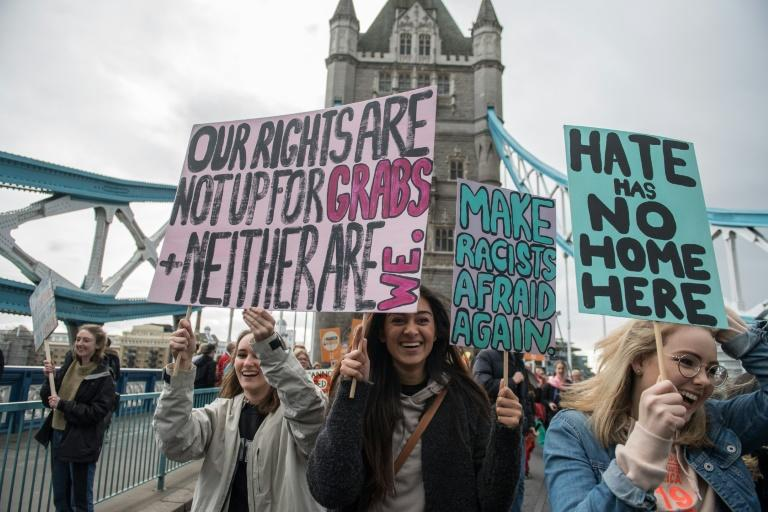 Women gather on Tower Bridge as they take part in a gender equality march organised by CARE International's #March4Women campaign, in London, on March 5, 2017, to mark the upcoming March 8 International Women's Day