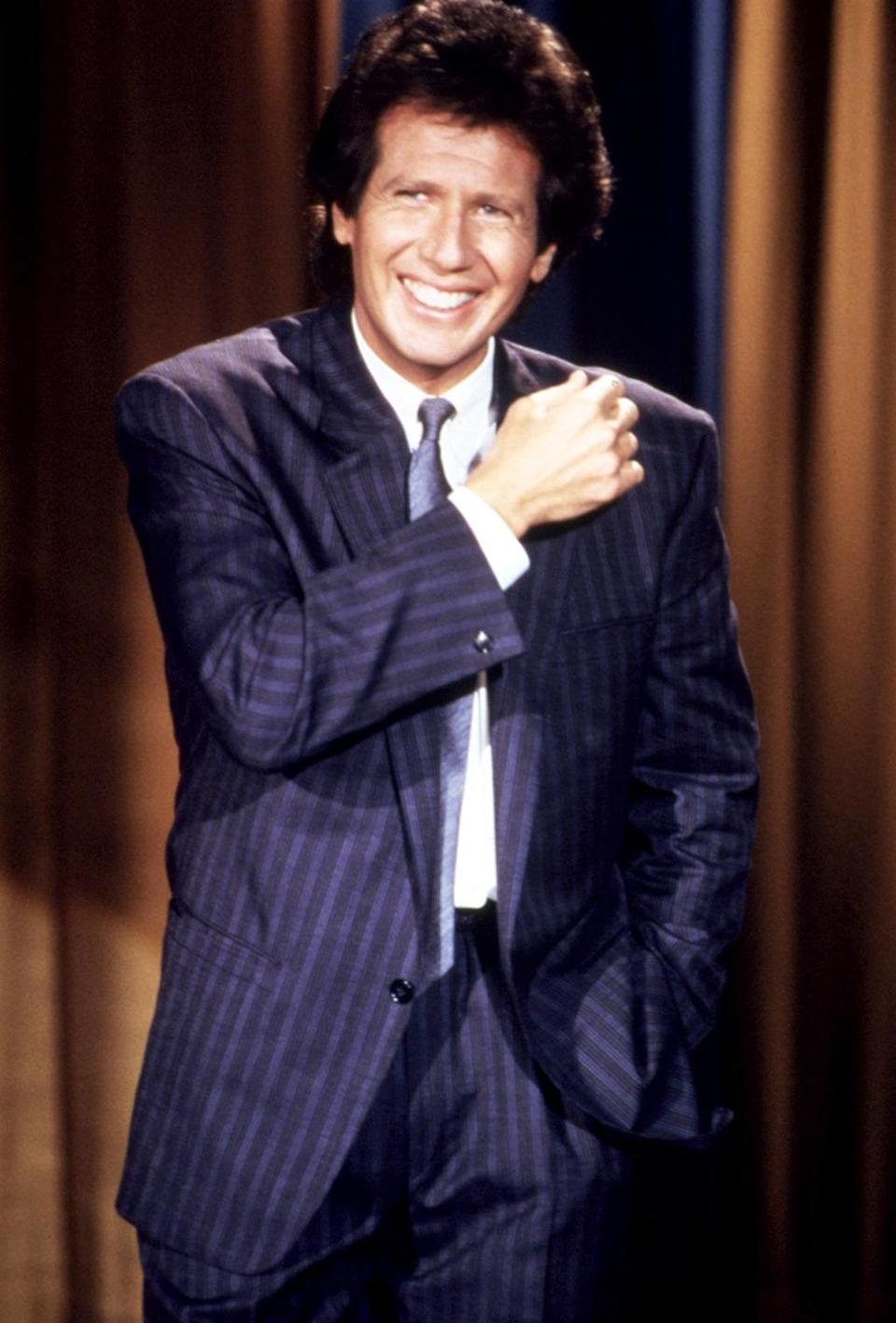 """<p><b>'The Tonight Show Starring Johnny Carson' (1981)</b></p><p>Initially making his name as a writer for <i>Sanford and Son</i> and <i>Welcome Back, Kotter</i>, Shandling made <a href=""""https://www.youtube.com/watch?v=Tg7fis-UY-s"""" rel=""""nofollow noopener"""" target=""""_blank"""" data-ylk=""""slk:his first network appearance as a stand-up comic"""" class=""""link rapid-noclick-resp"""">his first network appearance as a stand-up comic</a> on <i>The Tonight Show Starring Johnny Carson</i>, the holy grail for comedians, on March 18, 1981. He'd become a frequent and favorite guest, and just five years later, received his first invite to sit in for Carson as guest host.</p><p><i>(Credit: Everett Collection)</i></p>"""