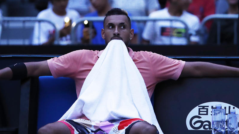 Nick Kyrgios pictured at Melbourne Park, sat back after the lights went out in the stadium.