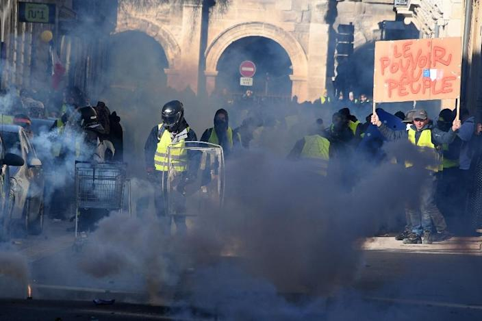 Police fired teargas in the southern city of Nimes (AFP Photo/Pascal GUYOT)