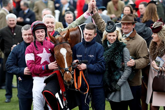Horse Racing - Cheltenham Festival - Cheltenham Racecourse, Cheltenham, Britain - March 14, 2018 Jack Kennedy celebrates with owner Michael O'Leary and trainer Gordon Elliott after riding Samcro to victory in the 13.30 Ballymore Novices' Hurdle REUTERS/Darren Staples