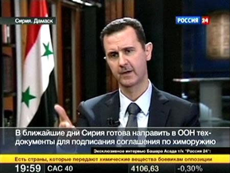 Image from RU24 video footage shows Syria's President Assad speaking during an interview in Damascus