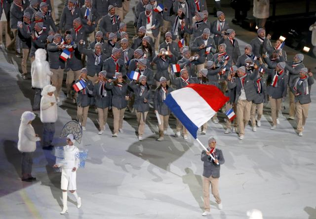 France's flag-bearer Jason Lamy Chappuis leads his country's contingent during the opening ceremony of the 2014 Sochi Winter Olympics, February 7, 2014. REUTERS/Issei Kato (RUSSIA - Tags: OLYMPICS SPORT)