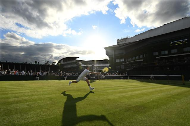 Miomir Kecmanovic of Serbia plays a forehand in his Men's Singles first round match against Roberto Carballes Baena of Spain during Day one of The Championships - Wimbledon 2019 at All England Lawn Tennis and Croquet Club on July 01, 2019 in London, England. (Photo by Matthias Hangst/Getty Images)