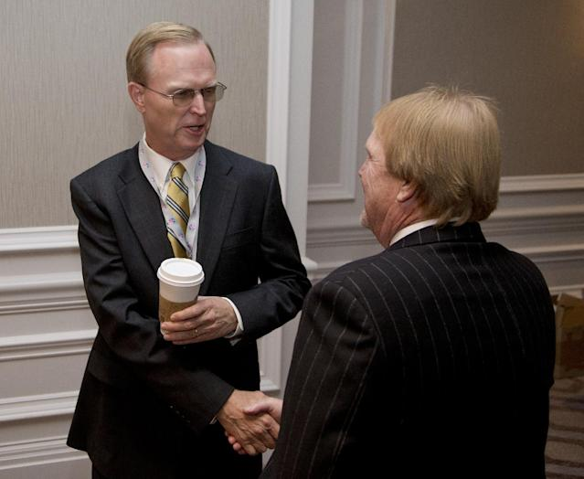 New York Giants football team owner John Mara, left, greets Oakland Raiders football team owner Mark Davis during the NFL fall meeting in Washington, Tuesday, Oct. 8, 2013. NFL owners hold their annual fall meeting, with discussions about the upcoming outdoor Super Bowl in New Jersey and player safety initiatives on the agenda. (AP Photo/Carolyn Kaster)