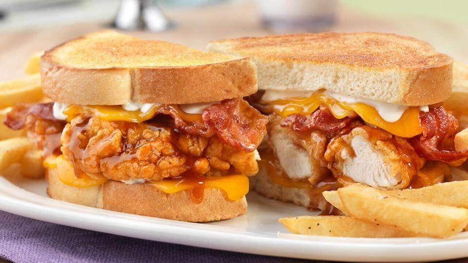 """<p>""""Country-breaded, all-white"""" chicken strips covered in honey barbecue sauce, melted cheddar cheese, applewood-smoked bacon, Ranch dressing, all piled together on grilled sourdough bread? How could the <a href=""""https://www.friendlysrestaurants.com/menu-item/honey-bbq-chicken-supermelt/"""" rel=""""nofollow noopener"""" target=""""_blank"""" data-ylk=""""slk:Honey BBQ Chicken SuperMelt Sandwich"""" class=""""link rapid-noclick-resp"""">Honey BBQ Chicken SuperMelt Sandwich</a> <em>not</em> be the most popular item on the Friendly's menu? Does any other item even have a <em>chance</em>? Sure, there's ice cream, which sounds like an essential dessert after your SuperMelt, but the SuperMelt is the main attraction with all its hearty, comfort-food dreaminess. </p>"""