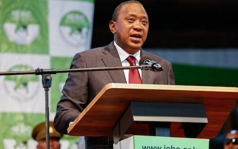 <span>President Uhuru Kenyatta delivers his speech after being declared by Kenya's election commission Independent Electoral and Boundaries Commission</span> <span>Credit: DANIEL IRUNGU/EPA </span>