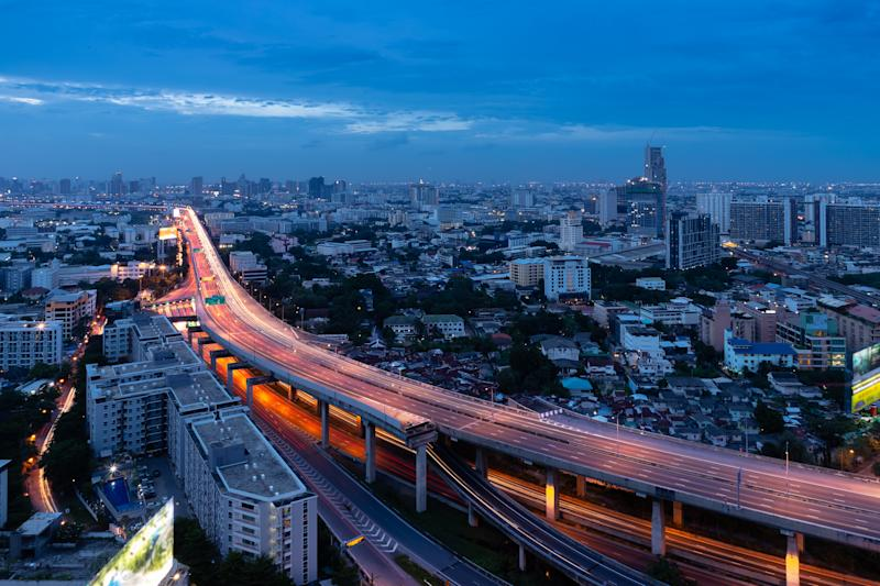 Expressway arial view during night with light trail, Bang Na, Bangkok Thailand