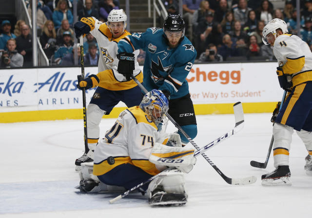 Nashville Predators goaltender Juuse Saros (74) blocks a shot of the San Jose Sharks' Barclay Goodrow (23) in the first period of an NHL hockey game in San Jose, Calif., Tuesday, Nov. 13, 2018. (AP Photo/Josie Lepe)