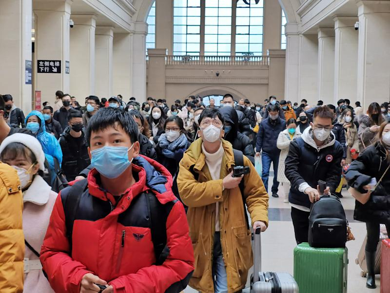 People wearing face masks while travelling. The World Health Organisation has declared the risk of the coronavirus spreading globally as 'very high'.