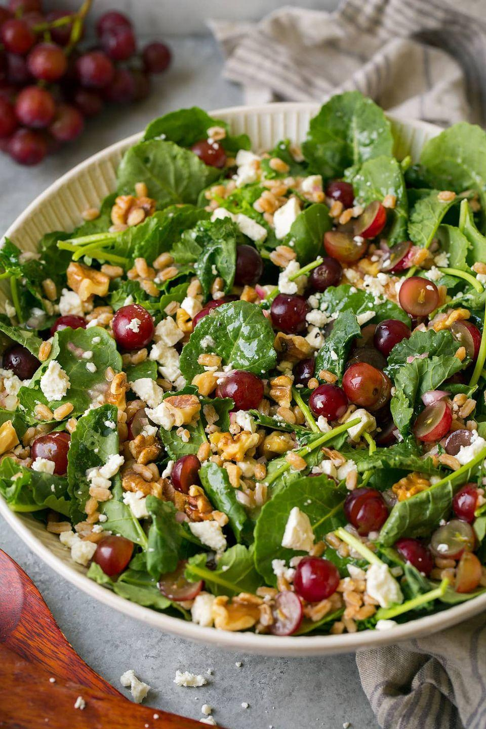"""<p>You can't go wrong by adding feta to a salad, especially when combining it with farro and kale.</p><p><strong>Get the recipe at <a href=""""https://www.cookingclassy.com/kale-grape-farro-salad/"""" rel=""""nofollow noopener"""" target=""""_blank"""" data-ylk=""""slk:Cooking Classy"""" class=""""link rapid-noclick-resp"""">Cooking Classy</a>.</strong> </p>"""