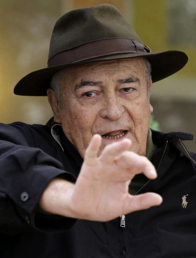 FILE - In this file photo taken on Oct. 18, 2012, Italian film director Bernardo Bertolucci poses for photographers during a photo call in Rome. Bertolucci was chosen Thursday, May 9, 2013, as the president of the jury of 70th edition of the Venice Film Festival that will take place from Aug. 28 to Sept. 7. (AP Photo/Andrew Medichini)
