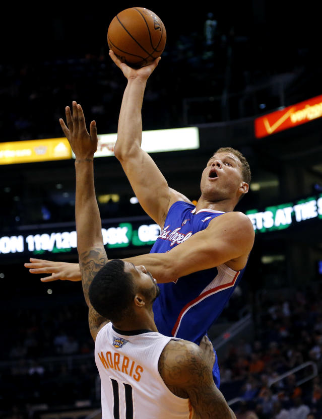 Los Angeles Clippers' Blake Griffin shoots over Phoenix Suns' Markieff Morris (11) during the first half of an NBA basketball game, Tuesday, March 4, 2014, in Phoenix. (AP Photo/Matt York)