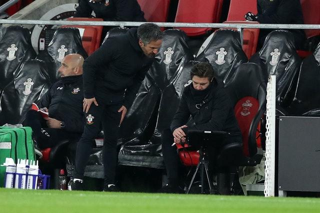 Coaches in conversation on Southampton bench during West Ham fixture