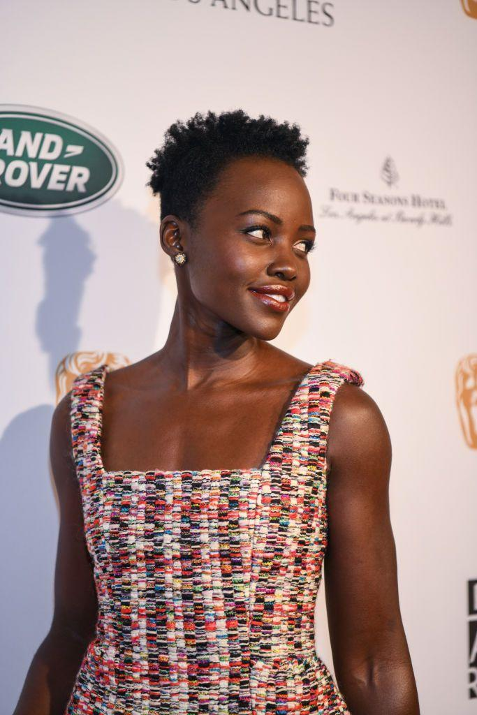 <p>The classic pixie cut—with cropped sides and length at the top—shines on Lupita Nyong'o. Style it with loosely defined curls, or sweep the longest pieces forward as bangs.</p>