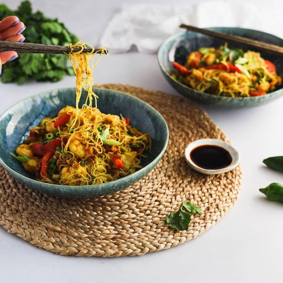 """<p>Singapore noodles is a Chinese takeaway classic. Complete with king prawns, shiitake mushrooms and frozen peas, this super-simple <a href=""""https://www.delish.com/uk/cooking/recipes/a30607809/chicken-broth/"""" rel=""""nofollow noopener"""" target=""""_blank"""" data-ylk=""""slk:noodle"""" class=""""link rapid-noclick-resp"""">noodle</a> recipe comes together in a matter of minutes! </p><p>Get the <a href=""""https://www.delish.com/uk/cooking/recipes/a36227169/singapore-noodles/"""" rel=""""nofollow noopener"""" target=""""_blank"""" data-ylk=""""slk:Singapore Noodles"""" class=""""link rapid-noclick-resp"""">Singapore Noodles</a> recipe.</p>"""