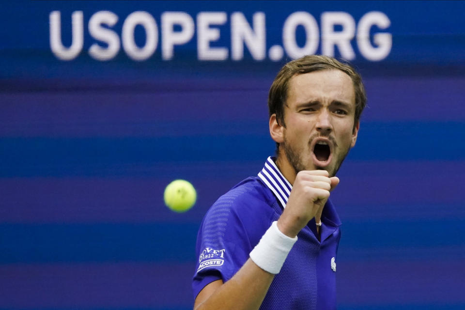 Daniil Medvedev, of Russia, reacts after scoring a point against Felix Auger-Aliassime, of Canada, during the semifinals of the US Open tennis championships, Friday, Sept. 10, 2021, in New York. (AP Photo/Seth Wenig)