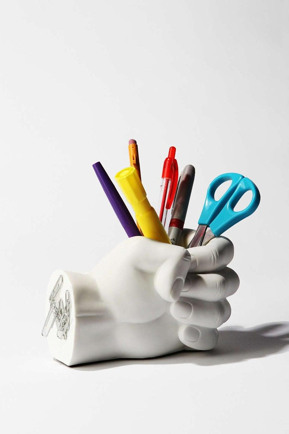 <p>Useful and whimsical, we're into this <span>Hand Pen Holder</span> ($20).</p>