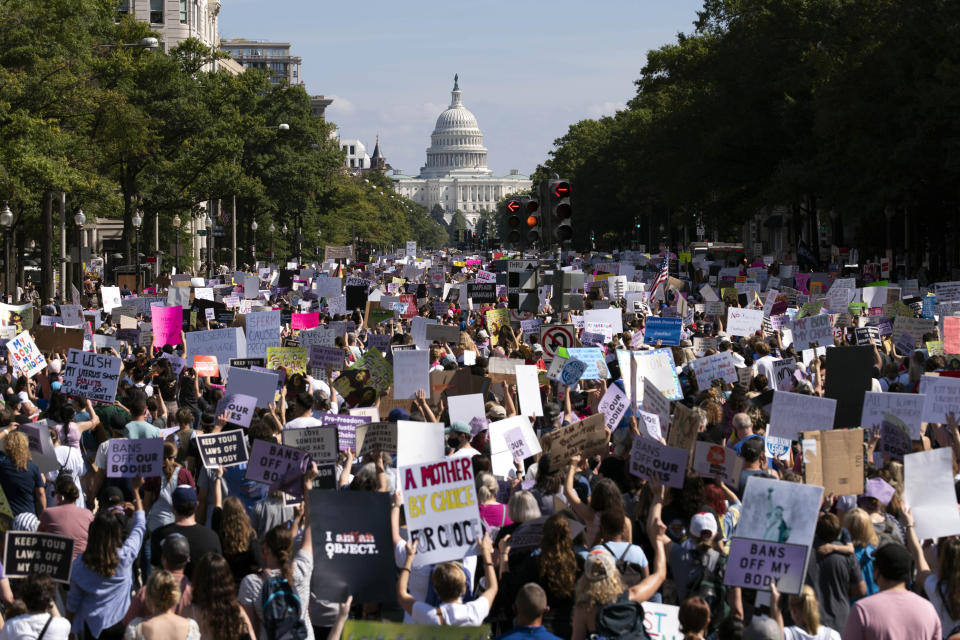 With the U.S Capitol in the background, thousands of demonstrators march on Pennsylvania Avenue during the Women's March in Washington, Saturday, Oct. 2, 2021. (AP Photo/Jose Luis Magana)