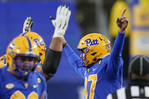 Pittsburgh place kicker Alex Kessman (97) celebrates after making his third field goal against Virginia Tech during the first half of an NCAA college football game, Saturday, Nov. 21, 2020, in Pittsburgh. (AP Photo/Keith Srakocic)