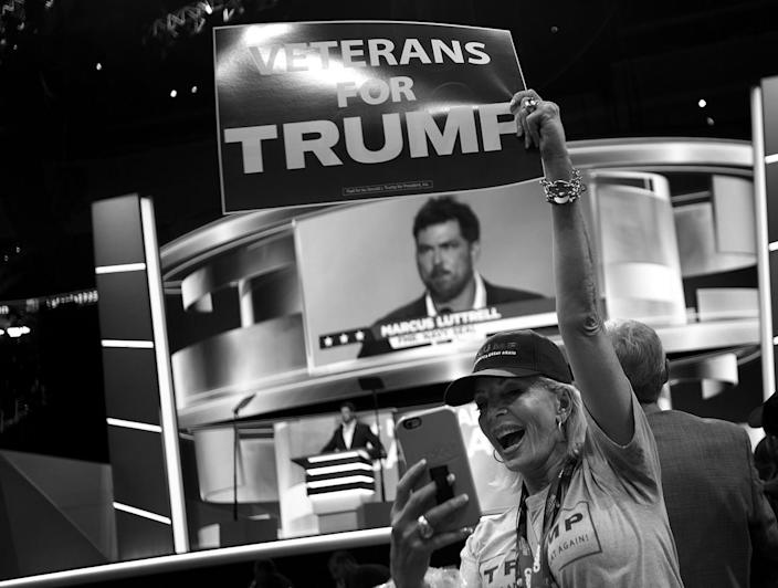 <p>Tina Hillstrom, a California delegate, takes a selfie as former Navy Seal Marcus Luttrell speaks at the Republican National Convention. (Photo: Khue Bui for Yahoo News)</p>