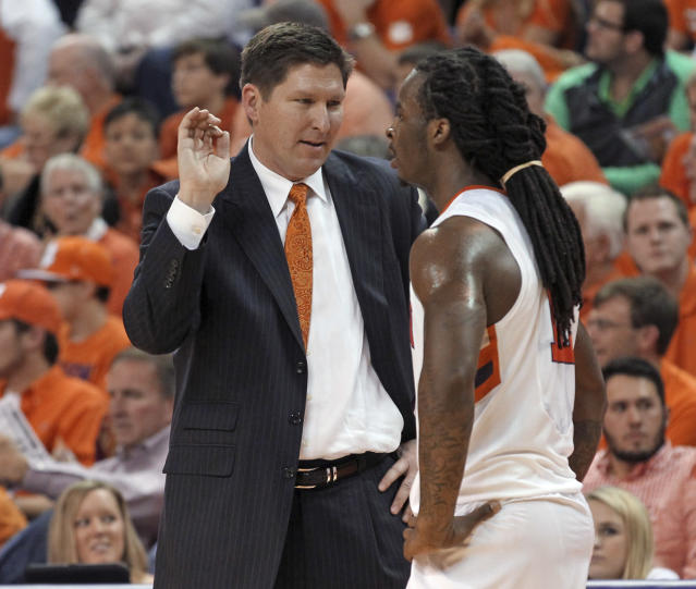 Clemson coach Brad Brownell, left, talks with point guard Rod Hall during an NCAA college basketball game against Duke on Saturday, Jan. 11, 2014, in Clemson, S.C. (AP Photo/Anderson Independent-Mail, Mark Crammer)