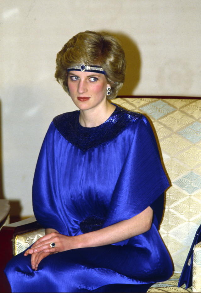 <p>At a dinner hosted by the Emperor of Japan, Diana wore a royal blue evening dress by designer Yuki and a stunning sapphire-and-diamond headpiece that featured elements taken from a watch. (Photo: Tim Graham/Getty Images) </p>