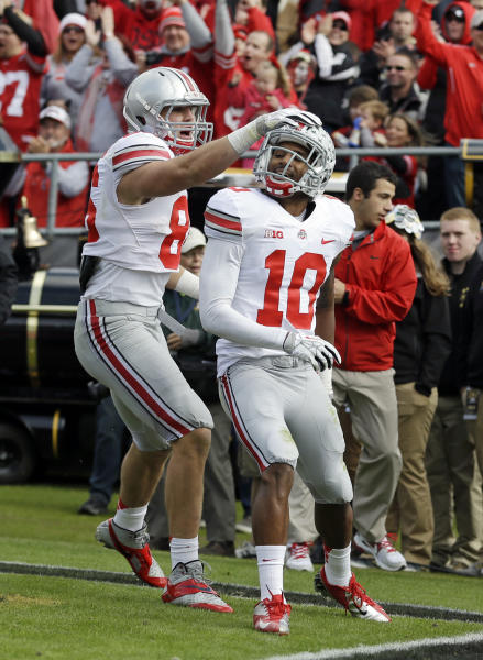 Ohio State wide receiver Philly Brown, right, celebrates a touchdown catch with tight end Jeff Heuerman during the first half of an NCAA college football game against Purdue in West Lafayette, Ind., Saturday, Nov. 2, 2013. (AP Photo/Michael Conroy)