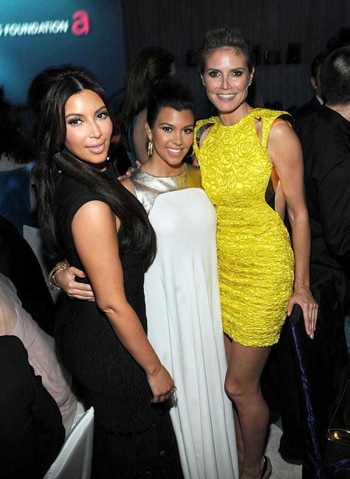 BEVERLY HILLS, CA - FEBRUARY 26:  (L-R) TV personalities Kim Kardashian and Kourtney Kardashian and model Heidi Klum attend the 20th Annual Elton John AIDS Foundation Academy Awards Viewing Party at The City of West Hollywood Park on February 26, 2012 in Beverly Hills, California.  (Photo by Larry Busacca/Getty Images for EJAF)