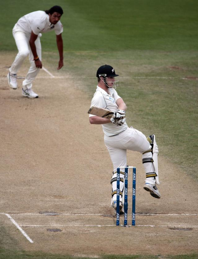 New Zealand's James Neesham plays a shot off India's Ishant Sharma during the second innings of play on day five of the second international test cricket match at the Basin Reserve in Wellington, February 18, 2014. REUTERS/Anthony Phelps (NEW ZEALAND - Tags: SPORT CRICKET)
