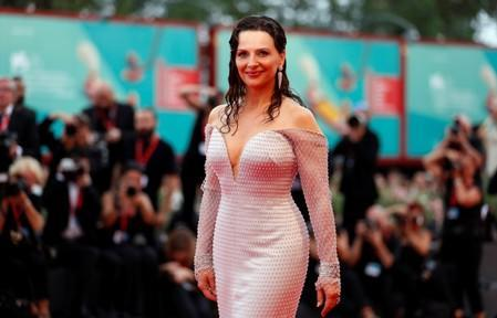 """French actor Binoche poses at the red carpet for the movie """"The Truth"""" (La Verite) presented in competition at the 76th Venice Film Festival"""