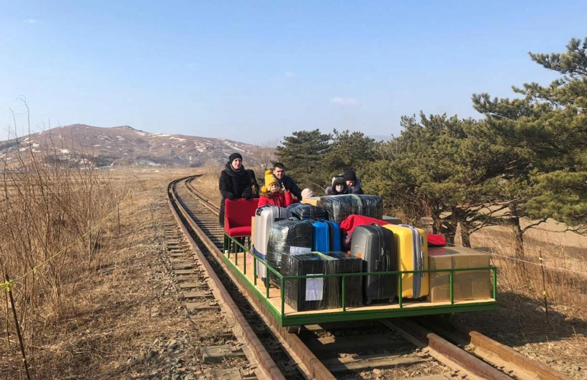 Russian diplomats leave North Korea by hand-pushed railcar after Covid closes borders