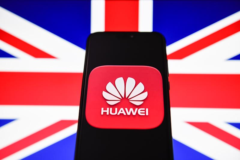 In this photo illustration a Huawei logo seen displayed on a smart phone with United Kingdom flag on the background. Photo Illustration by Omar Marques/SOPA Images/LightRocket via Getty Images