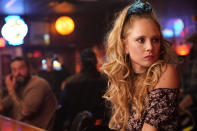 "This image released by Apple shows Juno Temple in a scene from ""Palmer."" (Apple via AP)"