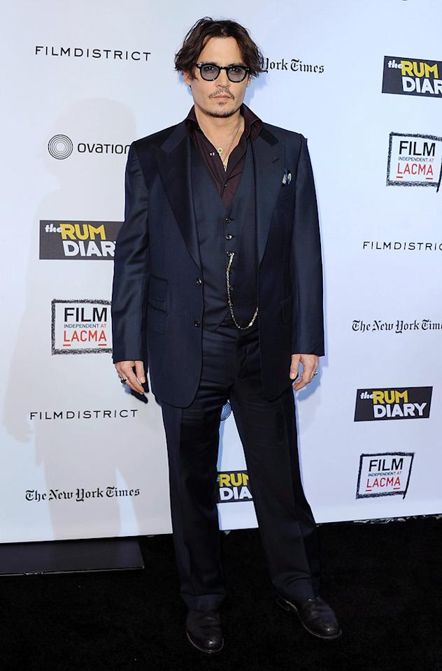 "<a href=""http://movies.yahoo.com/movie/contributor/1800019485"">Johnny Depp</a> at the Los Angeles premiere of <a href=""http://movies.yahoo.com/movie/1810077951/info"">The Rum Diary</a> on October 13, 2011."