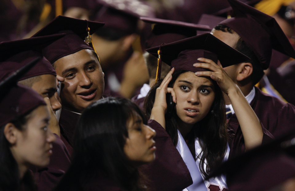 Arizona State University graduate students are seen in their seats during their graduation ceremony in Tempe, Arizona.(Photo by Joshua Lott/Getty Images)