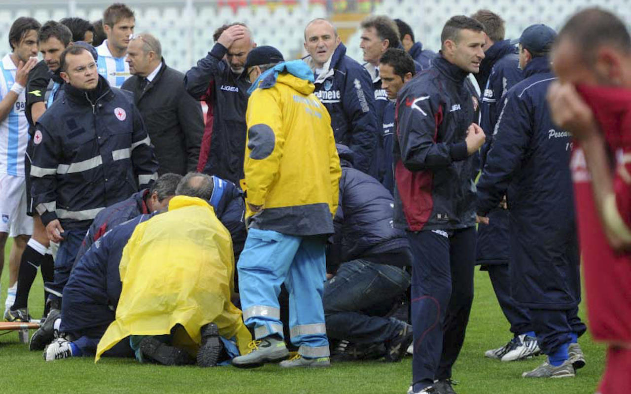 Medics assists Livorno's Piermario Morosini, not shown, as he lies on the turf of the Pescara's Adriatico stadium, central Italy, Saturday, April 14, 2012, during a Serie B soccer match between Pescara and Livorno. Morosini, who was on loan from Udinese, fell to the ground in the 31st minute of the match and received urgent medical attention on the pitch. A defibrillator was also used on the 25-year-old, who was later confirmed top have died. The match was called off, with the other players leaving the field in tears. (AP Photo/Cristiano Chiodi, Lapresse) ITALY OUT
